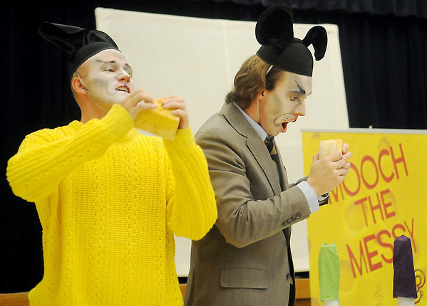 Zac Angle (left) portrays Mooch the Messy as Alexander Elliott plays Mooch's father during the studio artists Tulsa Opera on Tour performance at Monroe Elementary. Mooch the Messy is a musical written by Marcus DeLoach based on the children's book by Marjorie Weinman Sharmat. (Staff Photo by BONNIE VCULEK)