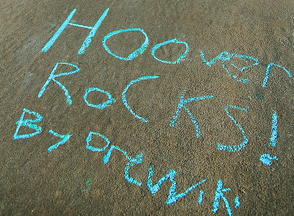 Chalk art by students at Hoover Elementary Monday as the school celebrated being named a National Blue Ribbon School by the US Department of Education. (Staff Photo by BILLY HEFTON)