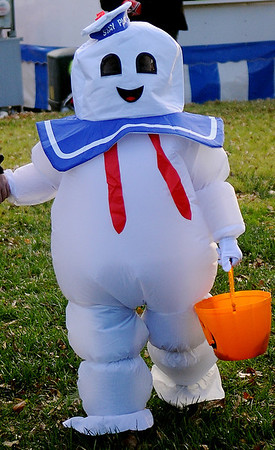 Lane Siemens, 6, arrives for Scare on the Square fun dressed as the Staples Marshmallow Man Saturday. (Staff Photo by BONNIE VCULEK)