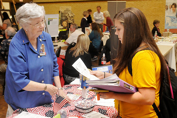 Shawna Perryman (right) visits with Lois Roberts, of the St. Mary's volunteer program, during the NOC Resource Fair Thursday at the Gantz Center. (Staff Photo by BILLY HEFTON)