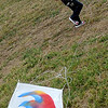 Little J.J. Jordan tries to fly her kite during the Rokkaku challenge Saturday at the American Kitefliers Association National Convention competition fields. (Staff Photo by BONNIE VCULEK)