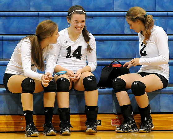 Oklahoma Bible Academy Lady Trojans relax courtside as they wait for Piedmont to arrive for the volleyball regional at OBA Friday. Since the Piedmont team was late for the early match, the scheduled games were rearranged. (Staff Photo by BONNIE VCULEK)