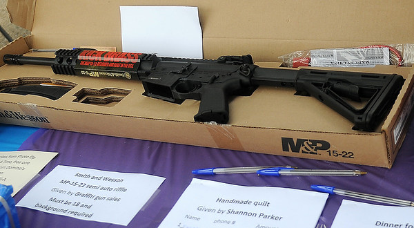 A Smith and Wesson MP-15-22 semi ato rifle donated by Graffiti Gun Sales was one of the most popular items included in the prize drawings during the 1st annual Sherry Suttmiller Memorial Softball Tournament Saturday. Suttmiller, wife of Enid Police officer Jeff Suttmiller, passed away May 23, 2012. (Staff Photo by BONNIE VCULEK)