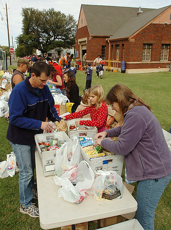 Volunteers sort through donated food Sunday during the fall food drive for Horn of Plenty. (Staff Photo by BILLY HEFTON)