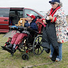 Ted Hayden (left) and his sister, Alice Hayden, from Hicksville, New York fly their kites Thursday during the American Kitefliers Association National Convention. Alice recalls fond memories of piloting kites as a young child with their parents during family picnics. (Staff Photo by BONNIE VCULEK)