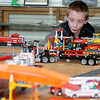 Ty Hamilton admires the Dream Valley Lego Train Layout at the Railroad Museum of Oklahoma Saturday. Three different Lego trains, tracks and assessories comprise the layout by Jody Zook, Sam Morgan and Louise Zook. (Staff Photo by BONNIE VCULEK)