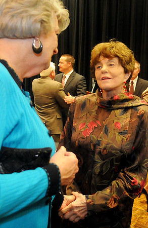 Joan Allen (right) receives congratulations from Marsha Scott Tuesday following the Enid Public School Foundation Hall of Fame Banquet at the Gantz Center on the Northern Oklahoma College-Enid campus. Joan and Paul Allen and Kay and Dan Dillingham were honored for their unselfish devotion and contributions to Enid Public Schools. (Staff Photo by BONNIE VCULEK)
