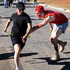 A runner tries to avoid a zombie Tuesday at Vance Air Force Base during the base's 5k Zombie Run. (Staff Photo by BILLY HEFTON)