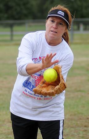 Cindy McFarland fields a throw during the 1st annual Sherry Suttmiller Memorial Softball Tournament at Kellett Field Saturday. (Staff Photo by BONNIE VCULEK)