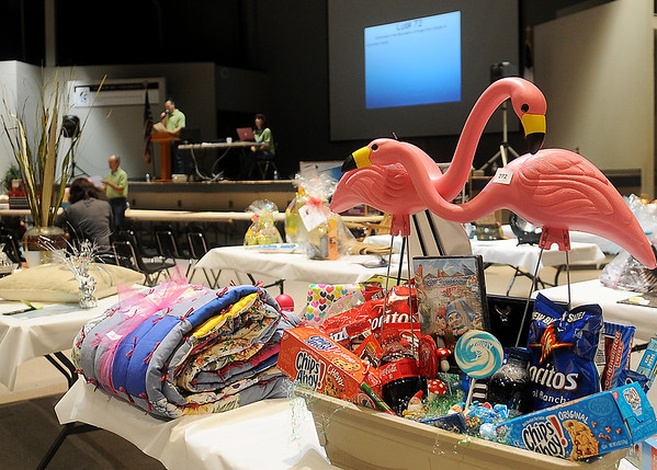 Silent auction items await pick-up as auctioneers accept bids from the crowd during Oklahoma Bible Academy's annual fundraising event Saturday. (Staff Photo by BONNIE VCULEK)
