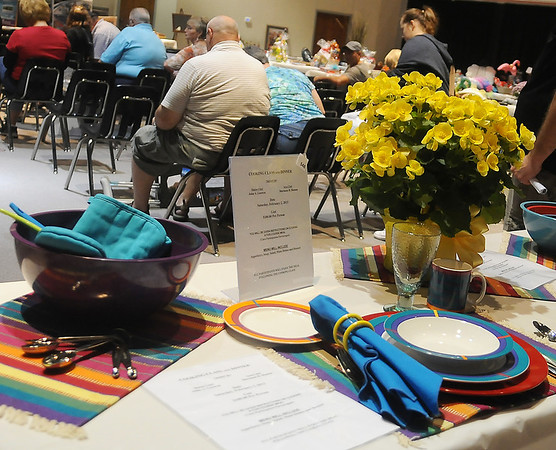 Cooking lessons and dinner were among the items available during the annual Oklahoma Bible Academy fundraising auction Saturday. (Staff Photo by BONNIE VCULEK)