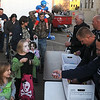 Enid Police Chief Brian O'Rourke and officers (right) pass out candy to Scare on the Square guests Saturday at the Garfield County Court House. (Staff Photo by BONNIE VCULEK)