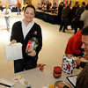 Holly McCormick beams with joy as she turns in more than $5,100 from Groendyke Transport, Inc. during the United Way Chili Cookoff Friday at the Cherokee Strip Conference Center. (Staff Photo by BONNIE VCULEK)
