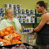 Linda Franklin answers a question for Derek Parks at Loaves & Fishes NW Oklahoma Thursday. The grand opening of the facility is slated for Tuesday, Oct. 23 from 11:00 a.m.-2:30 p.m. The client pantry which offers healthy food choices based on a point system will be open Wednesday and Friday from 10 a.m.-3 p.m., Tuesday and Thursday from 4-7 p.m. and every third Saturday of the month from 10 a.m.-1 p.m. (Staff Photo by BONNIE VCULEK)