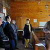 Cody Jolliff, education director at the Cherokee Strip Regional Heritage Center, talks about the land run to a delegation of Russian educators, community leaders and local government officials during their visit to the Humphrey Heritage Village. (Staff Photo by BILLY HEFTON)