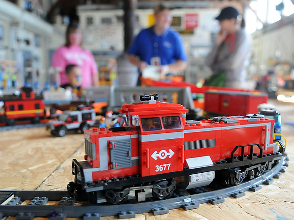 Parents and children enjoy the Lego train show at the Railroad Museum of Oklahoma Saturday. The layout featured three different trains, tracks and assessories designed by Jody and Louise Zook from Crescent and Sam Morgan from Enid. (Staff Photo by BONNIE VCULEK)