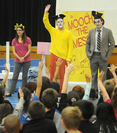 Whitney Hollis, Zac Angle and Alexander Elliott, from Tulsa Opea on Tour, answer questions Wednesday following the performance of Mooch the Messy at Monroe Elementary School. Mooch the Messy is a musical written by Marcus DeLoach based on the children's book by Marjorie Weinman Sharmat. (Staff Photo by BONNIE VCULEK)