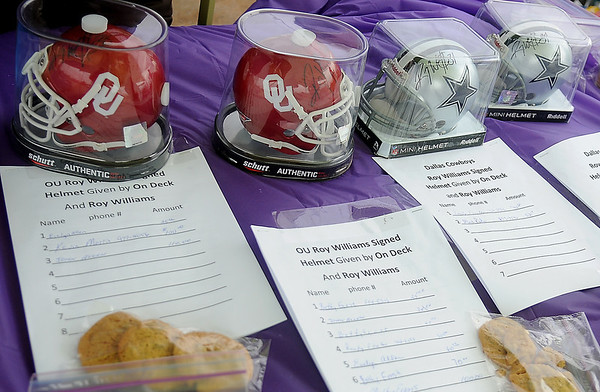 Roy Williams signed authentic miniature football helmets were among the silent auction items at the 1st annual Sherry Suttmiller Memorial Softball Tournament Saturday. (Staff Photo by BONNIE VCULEK)