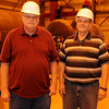 Glenn Snapp (left) and George Barber pause inside Pelagic Tank, LLC. The Enid business is a recipient of the Quality Jobs Program incentive. (Staff Photo by BONNIE VCULEK)