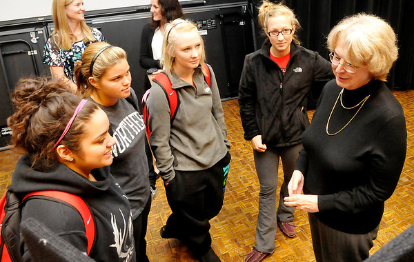 Linda Isaak, BCBA, with Aspire Oklahoma, visits with students during the NOC Resource Fair Thursday at the Gantz Center. (Staff Photo by BILLY HEFTON)