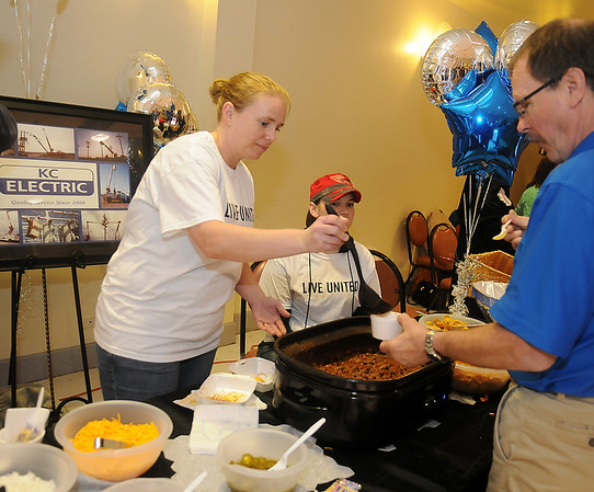 """Maria Miller fills a bowl of chili during the 25th annual United Way Chili Cookoff Friday at the Cherokee Strip Conference Center. KC Electric's chili was selected as the """"Healthiest Chili"""" during the event. (Staff Photo by BONNIE VCULEK)"""