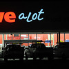 Construction vehicles are silhouetted in front of the new Save a Lot on S. Van Buren late Friday evening as workers hustle to get the business ready for Monday's opening day. (Staff Photo by BONNIE VCULEK)