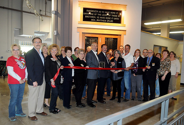 Enid Chamber of Commerce representatives gather inside CDSA for the grand opening ribbon cutting and open house Friday. (Staff Photo by BONNIE VCULEK)