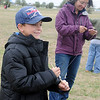 Austin Davidson (left) smiles after winning the first mini Rokkaku kite challenge Saturday during the American Kitefliers Association National Convention competition on the field south of Autry Technology Center. (Staff Photo by BONNIE VCULEK)