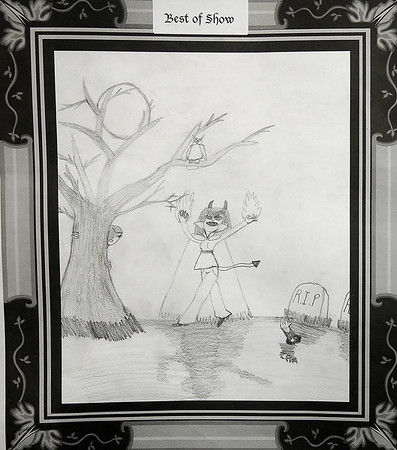 """Jazmin Barron, a 9-year-old 3rd grade student from McKinley Elementary School, won the distinguished """"Best of Show"""" artist award for the Enid Public Schools 3rd grade Leonardo da Vinci Monster Drawing Contest. An award party is slated for October 27 at 10 a.m. (Staff Photo by BONNIE VCULEK)"""