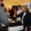 Sandi Gragg and Janie Carpenter serve Oklahoma Natural Gas's award-winning chili during the United Way Chili Cook Off Friday at the Cherokee Strip Conference Center. (Staff Photo by BONNIE VCULEK)