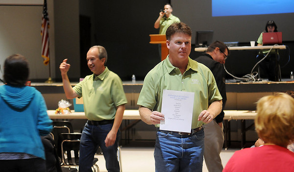 Lippard Auctioneers accept bids during Oklahoma Bible Academy's annual fundraising event Saturday. (Staff Photo by BONNIE VCULEK)