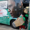 Cooper Newport (front) and Alex Jolly exit the Americans for Prosperity bus during Obama's Failing Agenda Tour Thursday on the Garfield County Court House lawn. (Staff Photo by BONNIE VCULEK)