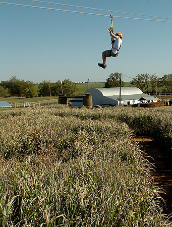 Luke Durbin takes the first ride on the newly added zip line at Daze in a Maze located south of Covington. (Staff Photo by BILLY HEFTON)
