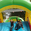 Kids slide down an inflatable Sunday during the YMCA Family Fun Day at Government Springs Park. (Staff Photo by BILLY HEFTON)