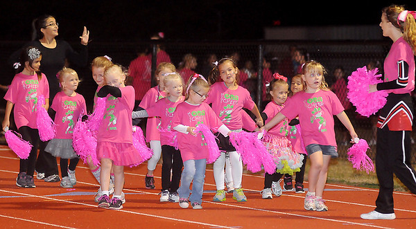 OBA Mini Cheerleaders prepare for their half-time show Friday at Commitment Field. (Staff Photo by BONNIE VCULEK)