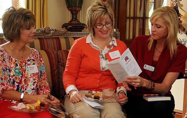 Vanessa Walker, Suzi Castillo and Kristi Orr (from left) discuss the variety of activities that the Garfield County Republican Women support Thursday during a tea in the home of Brent and Marcy Price. (Staff Photo by BONNIE VCULEK)