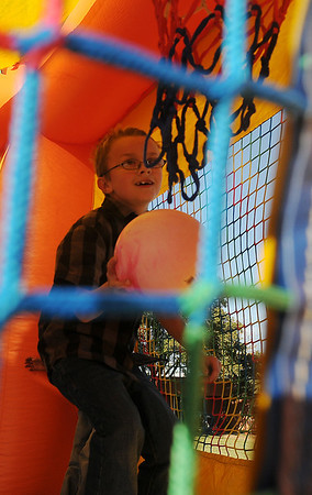 """A young man plays """"Moonwalk Basketball"""" during Oktoberfest at The Commons Friday. (Staff Photo by BONNIE VCULEK)"""