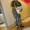 Skyler Mora broadcasts epoxy flooring in the new kitchen and service corridor Thursday at Convention Hall. The grand opening of the downtown event center is slated for November 18. (Staff Photo by BONNIE VCULEK)
