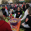 Thousands costumed children and their parents make their way around the Garfield County Court House lawn as they collect their sweet treats at Scare on the Square Saturday. (Staff Photo by BONNIE VCULEK)
