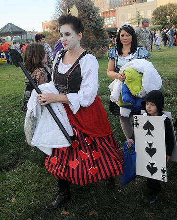 Suzanne Hale portrays the Queen of Hearts as Christian Cambron, the 3 of spades, collect treats during Scare on the Square festivities at the Garfield County Court House Saturday. (Staff Photo by BONNIE VCULEK)