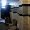 Tile work inside the new Convention Hall restrooms nears completion Thursday. The grand opening of the event center is slated November 18. (Staff Photo by BONNIE VCULEK)