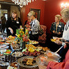 Garfield County Republican Women enjoy food and beverages during a membership tea in the home of Brent and Marcy Price Thursday. (Staff Photo by BONNIE VCULEK)