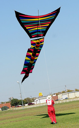 Adrian Conn, from Windsor, Ontario Canada, flies his designed kitemaker's competition GEO 27, a 206 square foot, 65 foot long, 11 foot across kite that features $2500 in one-half ounce polyester rip stop material with polycarbonate coating. His creation took more than 600 hours in 30 days to complete for the American Kitefliers Association National Convention competition in Enid. (Staff Photo by BONNIE VCULEK)