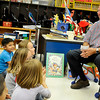 Enid mayor, Bill Shewey, laughs as he visits with kindergartners at Taft Elementary Monday. (Staff Photo by BILLY HEFTON)