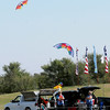 As competitors await their competition Tuesday, two precision kites fly overhead during the American Kitefliers Association Convention south of Autry Technology Center. (Staff Photo by BONNIE VCULEK)
