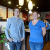 Jordan Allen (left), the new owner of Davinci's Coffee House, and Mandy McAlister, the business manager, pause for a portrait at 2315 W. Willow Road Monday. Allen graduated from high school two years ago and is excited about his new business venture in Enid. (Staff Photo by BONNIE VCULEK)