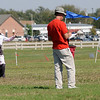 Mark Quinbach (left), from California, competes in the American Kitefliers Association open individual freestyle with his quad line kite as a judge (right) records Quinbach's scores Tuesday afternoon. (Staff Photo by BONNIE VCULEK)