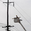An Oklahoma Gas & Electric employee replaces a high line support on Cleveland as Enid residents deal with power outages after heavy rains moved across Garfield County Friday. (Staff Photo by BONNIE VCULEK)