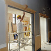 Terry Jones, from Oklahoma City, drywalls the interior of Convention Hall Thursday. The grand opening of the new event center is slated for November 18. ( Staff Photo by BONNIE VCULEK)