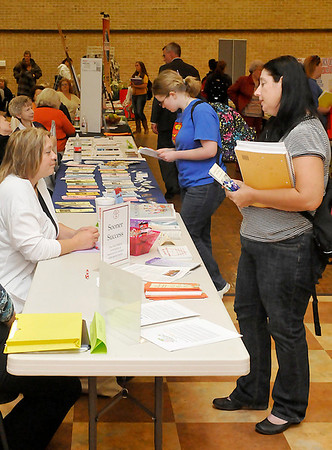 Students visit booths during the NOC Resource Fair Thursday at the Gantz Center. (Staff Photo by BILLY HEFTON)